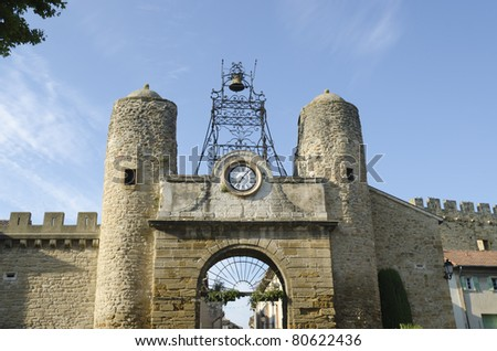 door old city walls of Camaret sur Aigues in Provence, France - stock photo
