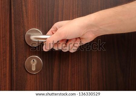 door with a hand on handle