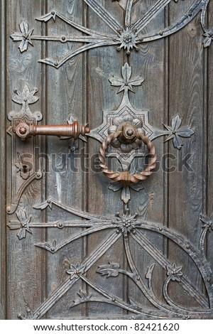 door with metal decorations - stock photo