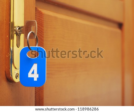 Door wood and key in keyhole with numbered label