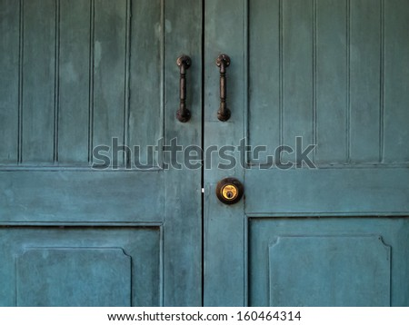 Doorknob and Metal door handle on Vintage Blue door