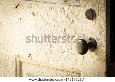 Doorknob on old weathered door #1481782874