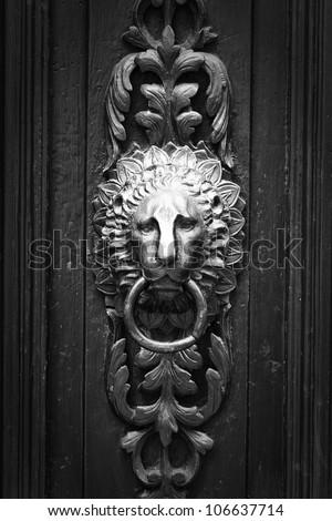 doorknocker like lion head  black and white