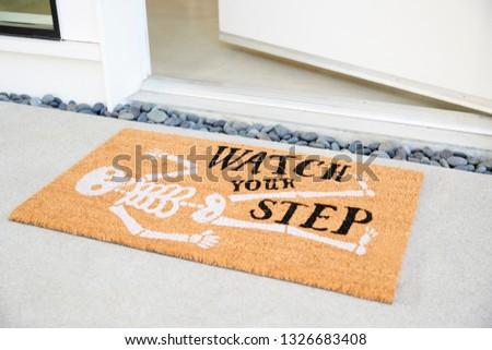 Doormat Outside Open Front Door Of House