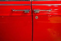 Doors of red retro car.