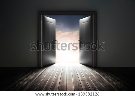Doors opening to reveal beautiful sky in dark grey room
