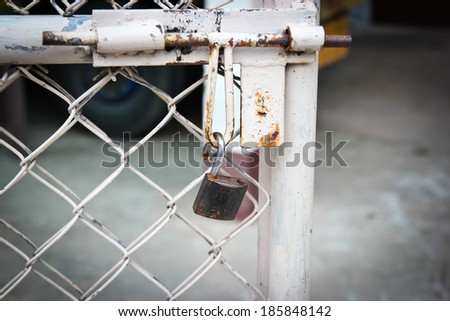 doors rusted iron fence