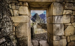 Doorway at Machu Picchu frames a view of Huayna Picchu,  Machu Picchu, Unesco World Heritage site, Sacred Valley, Peru