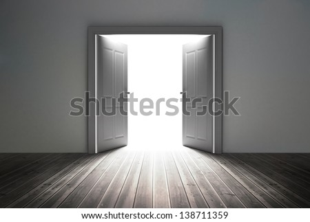 Doorway revealing bright light in dull grey room
