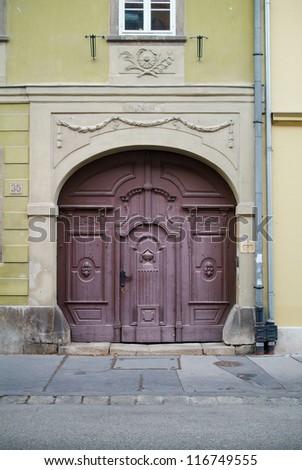 Doorway to old tenement house. - stock photo