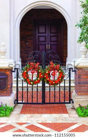 Doorway with Christmas decorative Wreath Hanging in Front of door