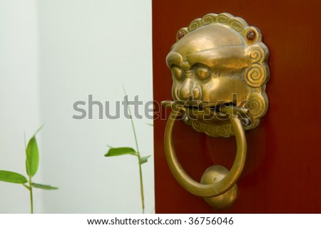 Doorways to traditional chinese temple with guardian door knocker