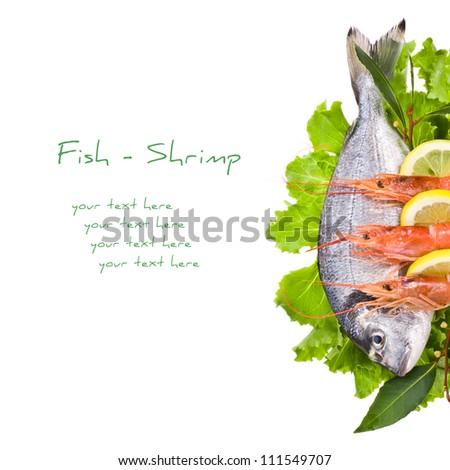 Dorado fish and shrimp with a lemon on fresh lettuce leaves isolated on a white background - stock photo