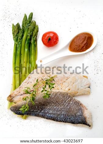 dorado, served with asparagus and tomato sauce