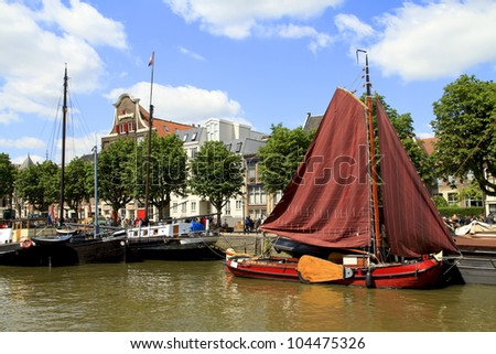 DORDRECHT, NETHERLANDS - JUNE 2 2012: Dordrecht in Steam, the largest steam power event in Europe. Historic boats in Wolwevershaven harbor on Saturday 2 June 2012 in Dordrecht.