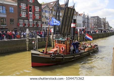 DORDRECHT, NETHERLANDS - JUNE 2 2012: Dordrecht in Steam, the largest steam power event in Europe. Ship, Jan de Sterke leaving harbor on Saturday 2 June 2012 in Dordrecht.