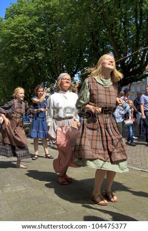 DORDRECHT, NETHERLANDS - JUNE 2 2012: Dordrecht in Steam, the largest steam power event in Europe. Unidentified children skipping in period dress on Saturday 2 June 2012 in Dordrecht.