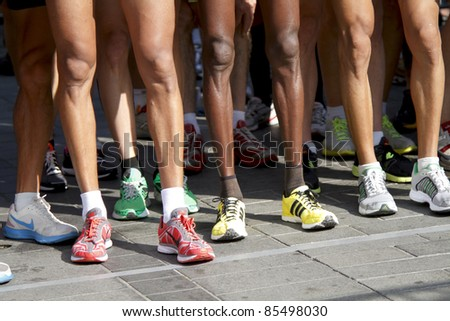 DORDRECHT, NETHERLANDS - SEPTEMBER 25: Runners stand on the line at the start of the Drechtstedenloop in Dordrecht on September 25, 2011. The race is a 10km and 5km street circuit for all ages.