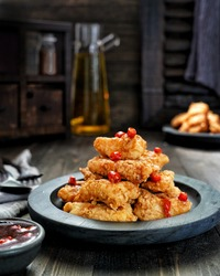 Dori fish in flour with sweet and sour sauce, Indonesian Food. Flour mix with garlic, salt, pepper, sugar and water. And then coat the fish with batter, and then fried on the pan with oil.