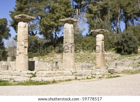 Doric columns of the ruins of a temple in ancient Olympia, the birthplace of the Olympic Games