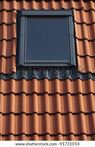 Dormer on a red tiled roof