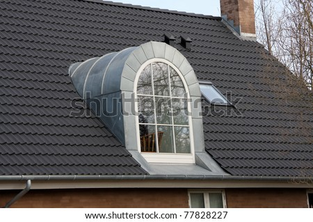 Dormer window of a house, Denmark, Europe