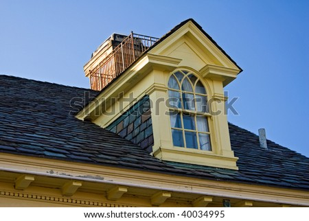 dormer window of mansion - stock photo