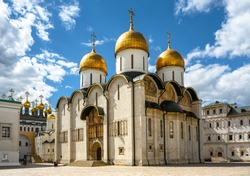 Dormition Cathedral (Assumption) inside Moscow Kremlin, Russia. It is famous landmark of Moscow. Russian Orthodox cathedral decorated with ancient frescoes. Old church in Moscow center in summer.