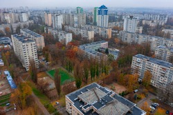 Dormitory district (bedroom community) of the Soviet architecture on a autumn foggy day. Residential apartment buildings (block of flats) of the Soviet period. Aerial view