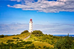 Dornbusch Lighthouse located in the north of the German island of Hiddensee in the Baltic Sea at sunny weather