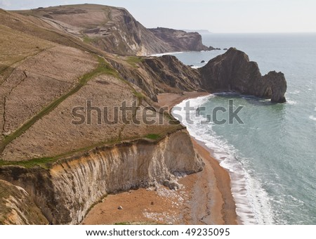 Dorset coastline looking down on Durdle Door, a natural sea arch part  of the Jurassic coast , England