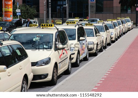 DORTMUND, GERMANY - JULY 16: Taxi drivers wait for passengers on July 16, 2012 in Dortmund, Germany. Taxi business is heavily regulated in Germany. Most of cities have typical cream-colored cabs.