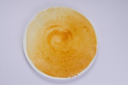 Dosa _Ghee roast Dosa,famous south Indian breakfast item which is made in caste iron pan in traditional way and arranged on a white plate ,on white background ,isolated.