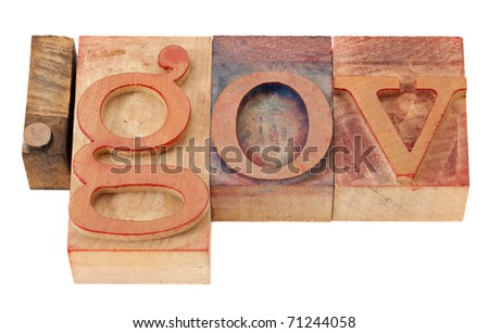 dot gov - internet domain for government  in vintage wooden letterpress printing blocks, stained by color inks, isolated on white