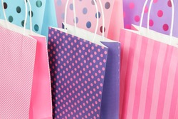 dotted and striped shopping bags close up