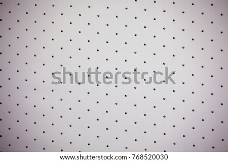 Dotted, spotted background on the piece of fabric with copy text. Polka dot style with bedotted dots. #768520030