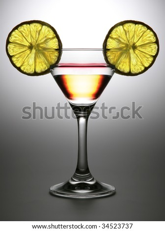 double alcoholic cocktail in tall wine glass with two transparent segment of the lemon