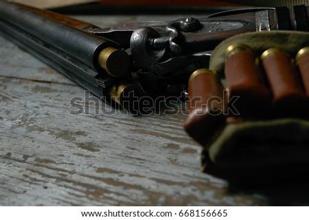 double barreled long gun riffle ...