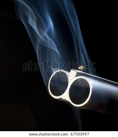 double barreled shotgun with smoke coming out of both barrels
