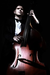 Double bass player contrabass playing. Jazz musician bassist