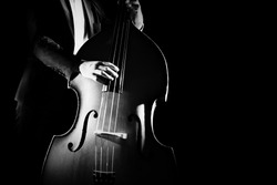 Double bass player playing contrabass classical music instrument