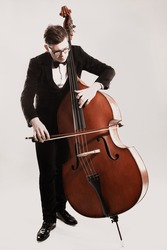 Double bass player playing contrabass Classical musician bassist.
