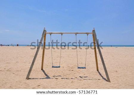 double beach swing over sand and blue sky background, Spain - stock photo