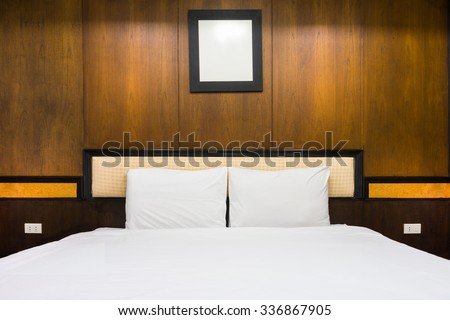 Double bed and furniture in bed room. The design of vintage interior decoration.