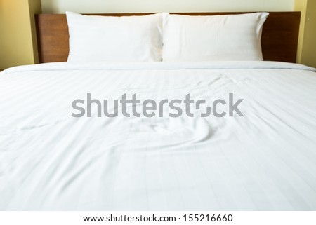Double bed in the modern interior room