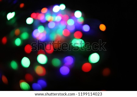 Double bokeh and Picture blurred Christmaslight pattern colours New on dark background.Use for website/banner, backdrop, montage
