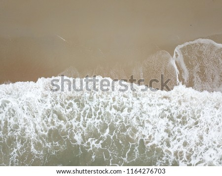 Double bokeh Beautiful sponge and tsunami is blowing to the shore.Use for website / banner background, backdrop, montage   #1164276703