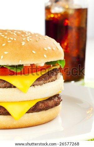 Double cheese burger on the white plate