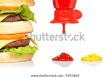 Double cheeseburger, mustard and pouring ketchup, reflected on white background