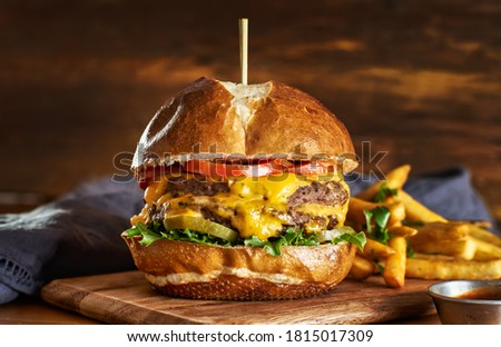 double cheeseburger with american cheese and fries on petezel bun Stock photo ©